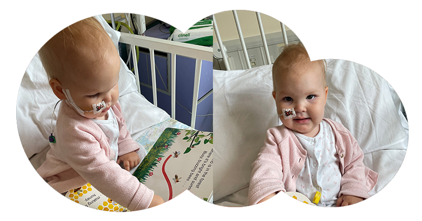 Primrose in her hospital bed with The Very Hungry Caterpillar's Hide and Seek book